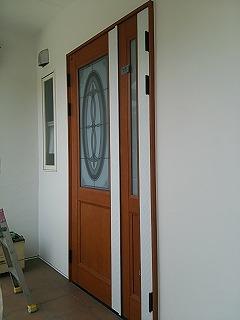 玄関ドア木目調シート張替え